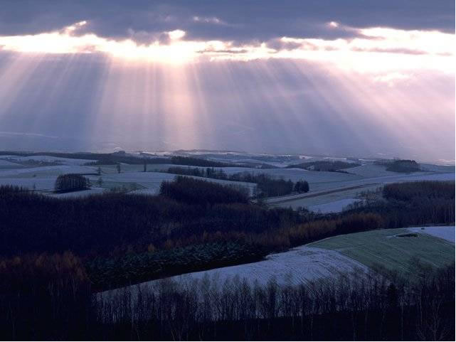 Sunrise about snowy fields