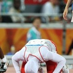 Bahraini runner Roqaya Al-Gassra prays after winning Olympics 200m