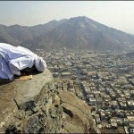 Praying on the edge of a cliff at Makkah
