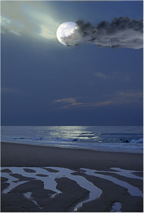 Moon over a beach at night