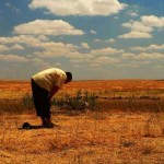 Muslim man prays at his farm