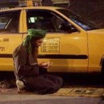 Muslim cabbie prays beside his taxi