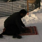 One brother praying on the snow