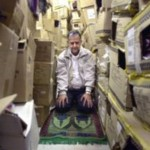 Praying in a cramped storage space
