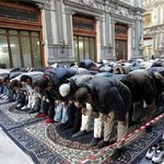 Muslim men bowing in salat