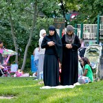 Muslim woman praying at Prospect Park in Brooklyn, New York