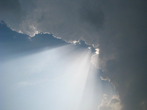 Sun rays coming from behind a cloud, sunrays