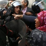 Female protester struggling with Egyptian police