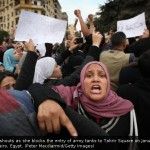 Blocking the entry of tanks to Tahrir Square on January 30, 2011