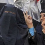 Egyptian women making victory signs