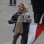 Child holds Egyptian flag