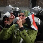 Female protester takes photos