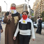 Mother and daughter cover their mouths with Egyptian flags