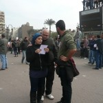 Egyptian woman reads a leaflet during protests