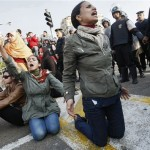 Egyptian demonstrators protest near Egyptian police (R) to demand the ouster of President Hosni Mubarak and calling for reforms on January 25, 2011. The protesters, carrying flags and chanting slogans against the government, rallied in a protest inspired by the uprising in Tunisia which led to the ouster of Zine El Abidine Ben Ali.