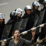 Woman defiant on the front lines during protests in Egypt