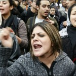 Egyptian demonstrators shout slogans as they attend a protest in Cairo demanding the ouster of President Hosni Mubarak on January 26, 2011. Egyptian police clashed with protesters in the centre of Cairo and in the port city of Suez, in the second day of nationwide anti-government demonstrations, an AFP reporter and witnesses said. AFP PHOTO/MOHAMMED ABED