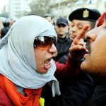 Female Egyptian protester shouting at police
