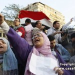 Egyptian woman holds her fist high during protests