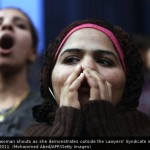 Young Egyptian woman shouts outside the Lawyers' Syndicate in Cairo