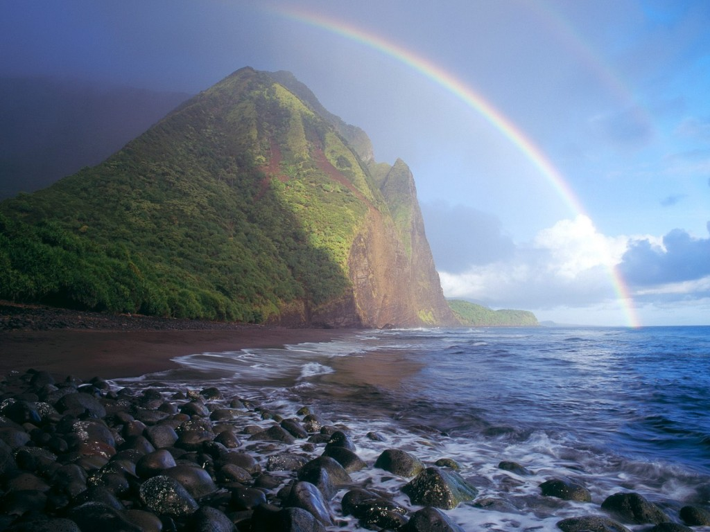 Misty rainbow in Waialu Valley, Hawaii