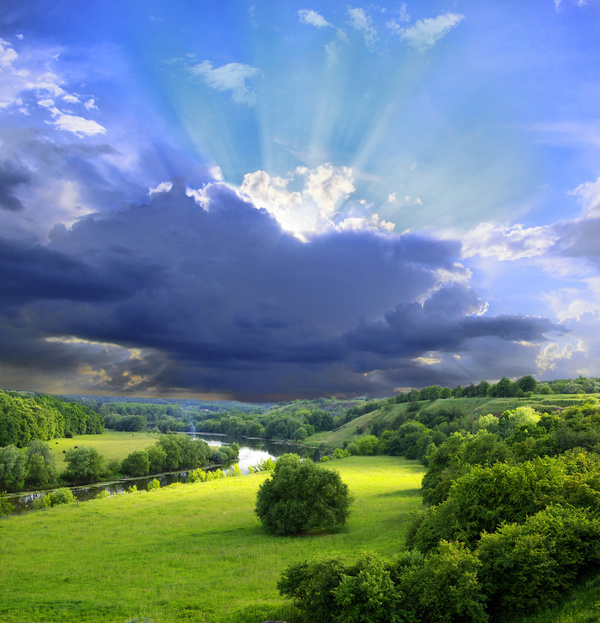 Amazing meadow, river, mountain and sunrays