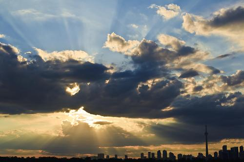 Sun rays over city skyline