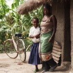 Sylvia and her mother outside their family home in rural Tanzania.