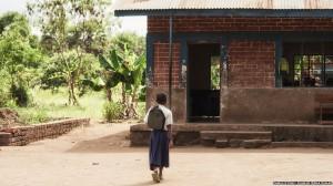 Tanzanian schoolgirl Sylvia arriving at her school.