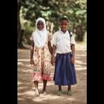 Tanzanian schoolgirl Sylvia and her Muslim friend Radhia.