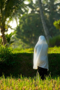 Muslim woman praying in Indonesia.