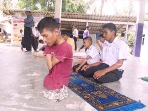 Disabled man with no legs leads the salat.