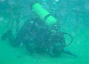 Muslim scuba diver prays underwater.