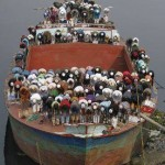 Muslim travelers pray on a small boat.