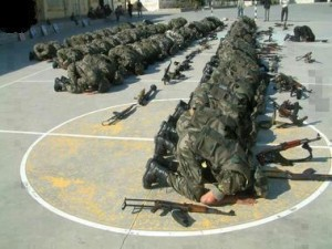 Pakistani army soldiers at prayer time.