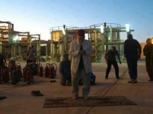 Muslim factory workers pray.