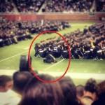 Muslim graduate stops to pray.