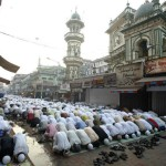 Muslims fill the street for Jum'ah.
