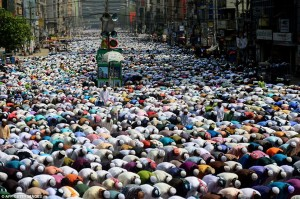 A sea of Muslims fills the street for prayer in Dhaka, Bangladesh.