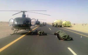 Soldiers praying on the road.
